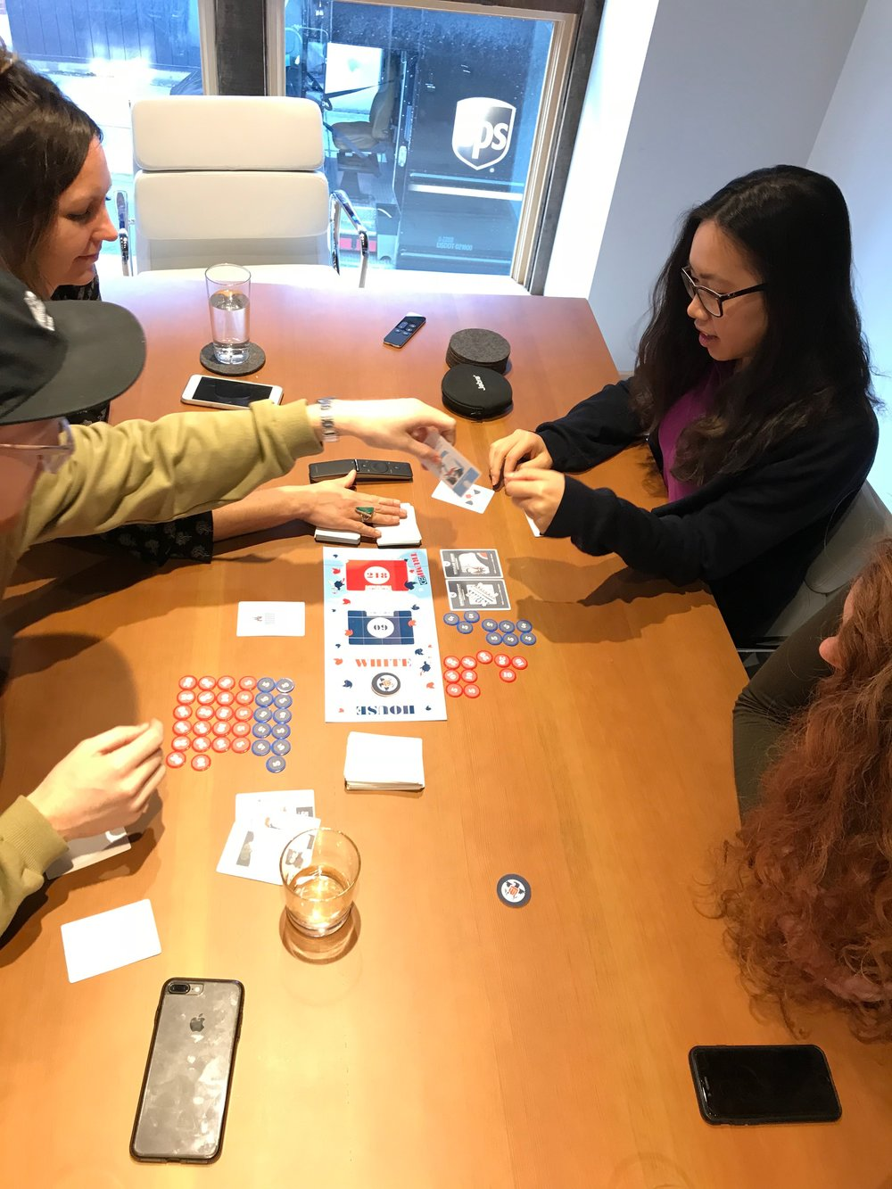 Team play testing early stage prototype