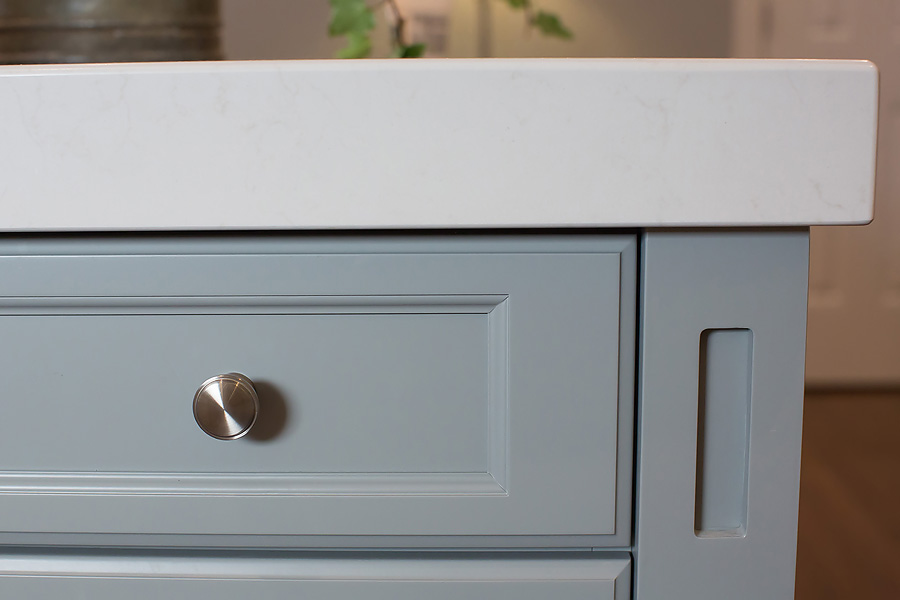Looks simple, right?  This is a close-up of a kitchen island we designed and decided to go with a thicker top.  Working in tandem, with all of the elements, meant we knew we'd have to adjust the drawers to be able to open under the drop-down of the counter face.  The side element was impacted, too.