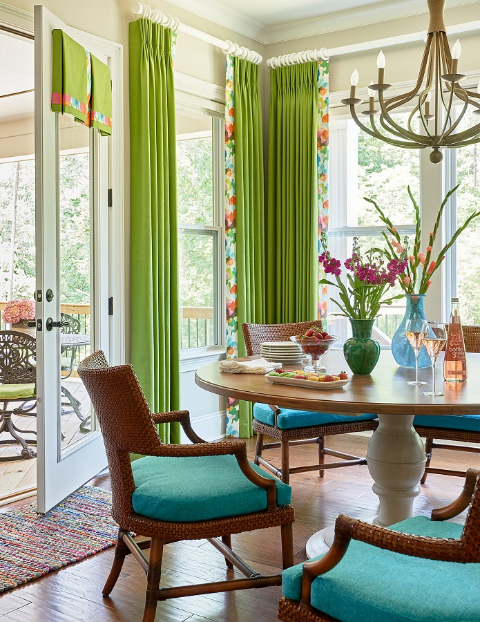 Casual dining room with green window treatments