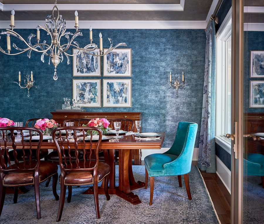 Blue formal dining room with traditional furniture and modern art