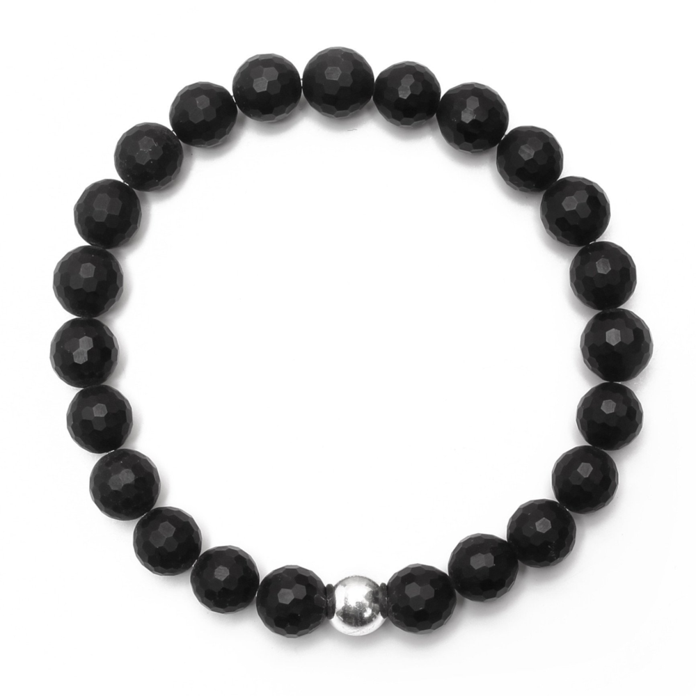 Matte 8MM Onyx Bracelet with Sterling Silver Ball  Embrace the power that lies within. Wear this onyx bracelet to overcome fears, inspire your confidence and show your true strength. 8mm matte faceted onyx, 8mm sterling silver bead, stretch elastic bracelet, hand-crafted in Bali and the USA. Includes complimentary Good Charma gift box.