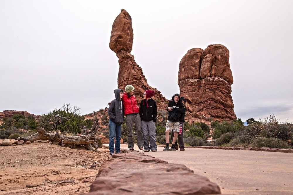 Two extremely rare things happening in this photo - Balancing Rock, and brothers and sisters hugging!