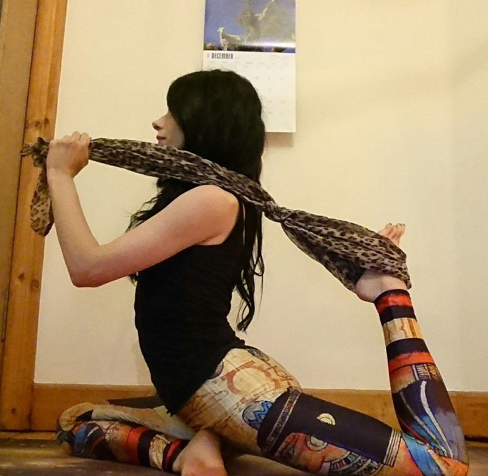 You can also use a yoga strap (or in my case, a scarf, they both work fine!) to bring your foot a little closer to your body, and it might be a little easier than reaching back for your foot initially. Just figure out what feels better for you!