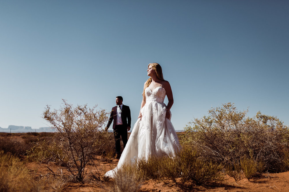married couple standing in the desert