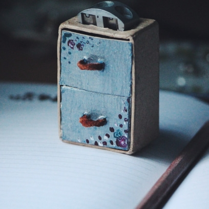 A pencil sharpener that is a chest of drawers.