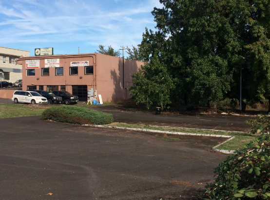 The future site of Coho Landing in South Downtown Milwaukie. The current building will be demolished.  Source.