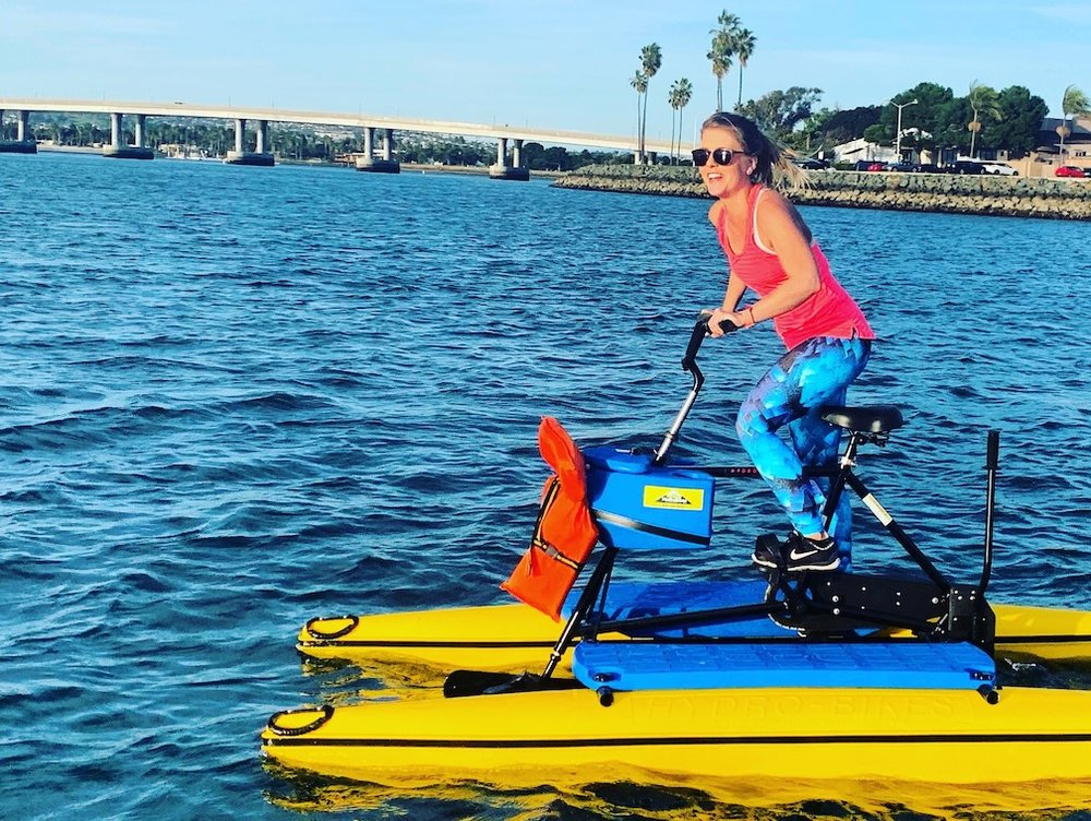 Hydrobike Bootcamp instructor Jana Valesova's professional mountain biking and Pilates experience brings a high-energy cycling vibe to Saturday classes!