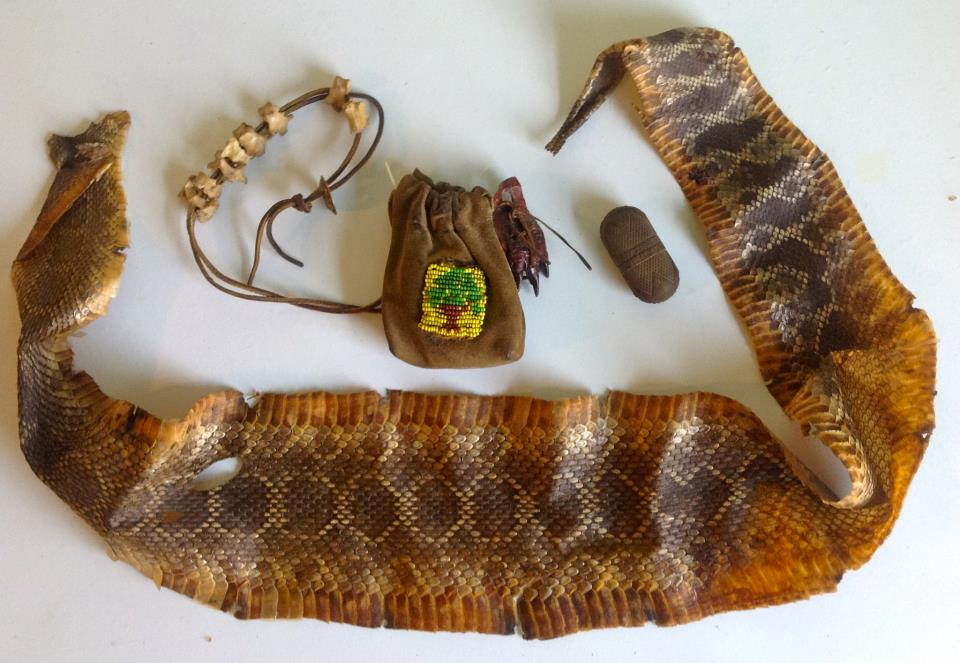 One of Dad's rattlesnake skins, along with his snake-bite kit and his medicine bag.