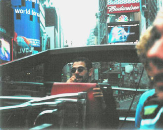 Here's an earlier version of me — singing my song for Gray Line New York Tours, 2001. Photo by Shayna Diamond.
