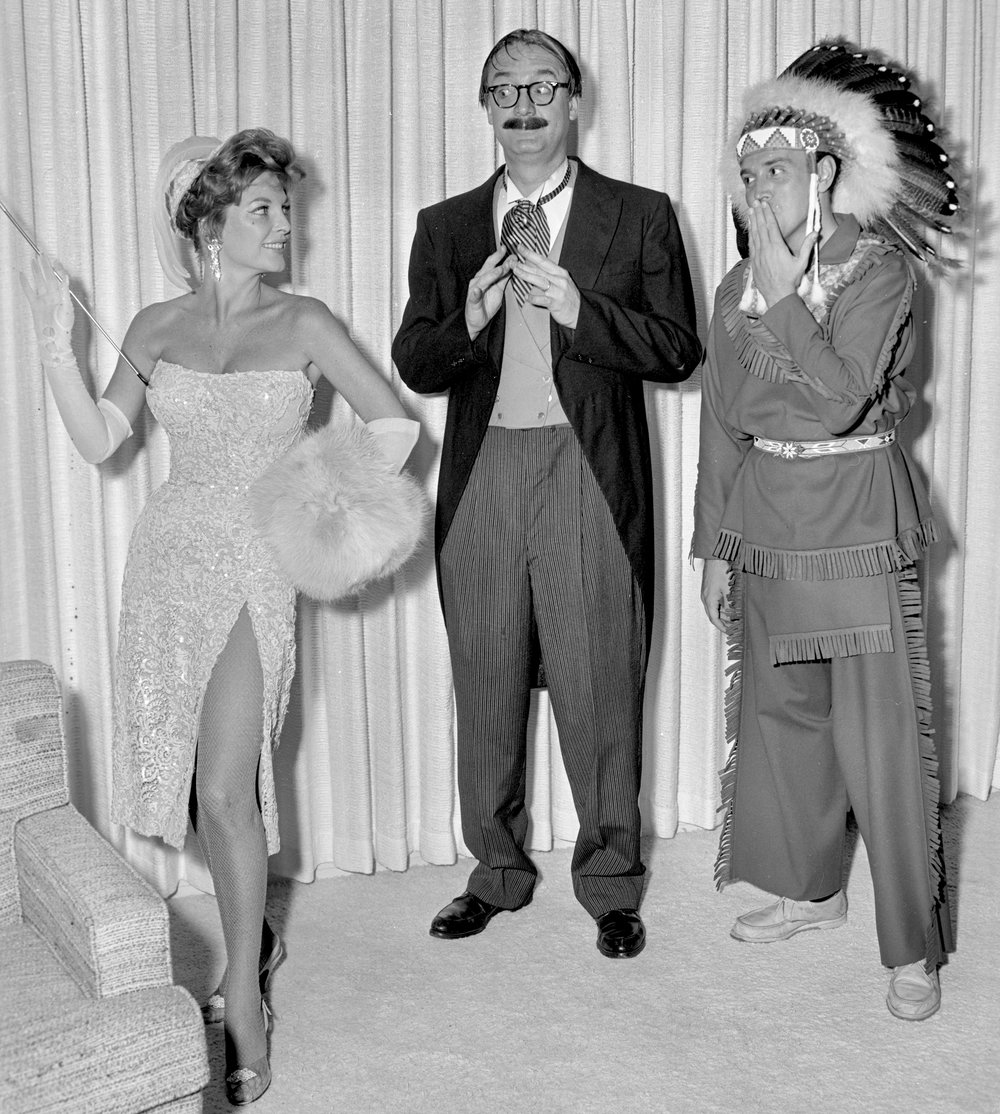 Julie London, Steve Allen, and Roger at a costume event
