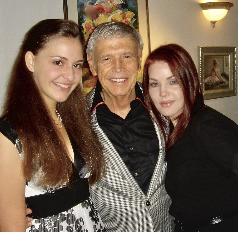 Roger, his granddaughter, and Priscilla Presley