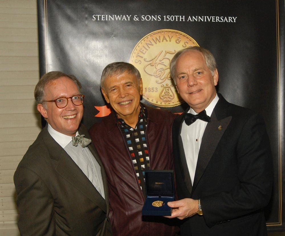 """Steinway executives present their """"Lifetime Achievement Award"""""""