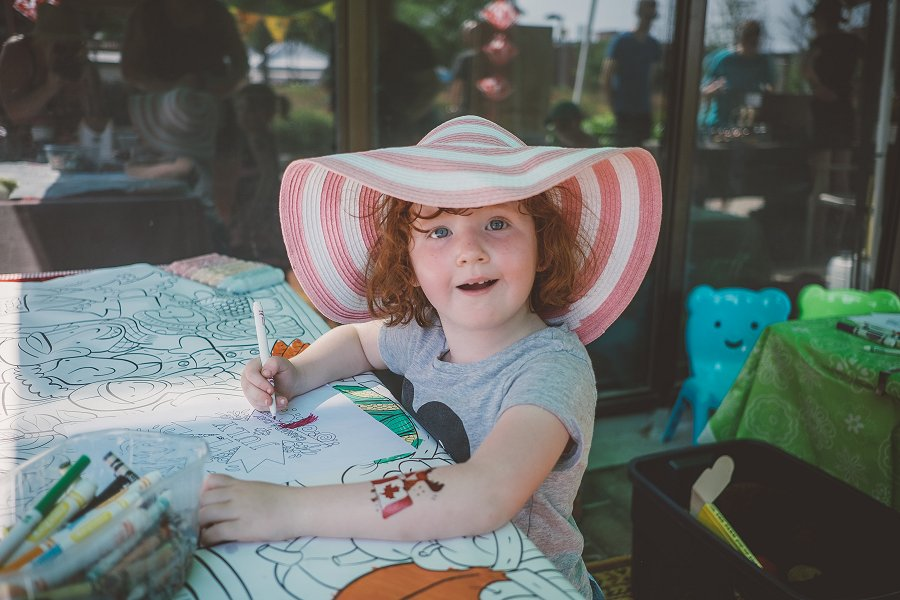 As well as local food, the Peterborough Regional Farmers' Market is a social asset for the community, with areas where shoppers can sit, eat, visit, engage, and linger, and family friendly, with a kids' zone that includes crafts, colouring, and water toys. (Photo: Jenn Austin-Driver)