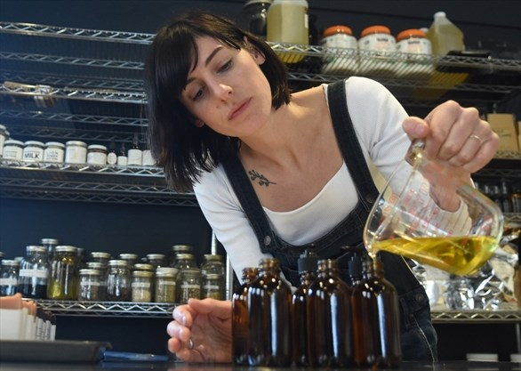 Nadine McCallem fills bottles with oils for products in her shop, Ritual Apothecary. Her business was the second to come out on top in the Win This Space contest, to which she received free rent for a downtown Peterborough storefront for one year. - Taylor Clysdale/Metroland
