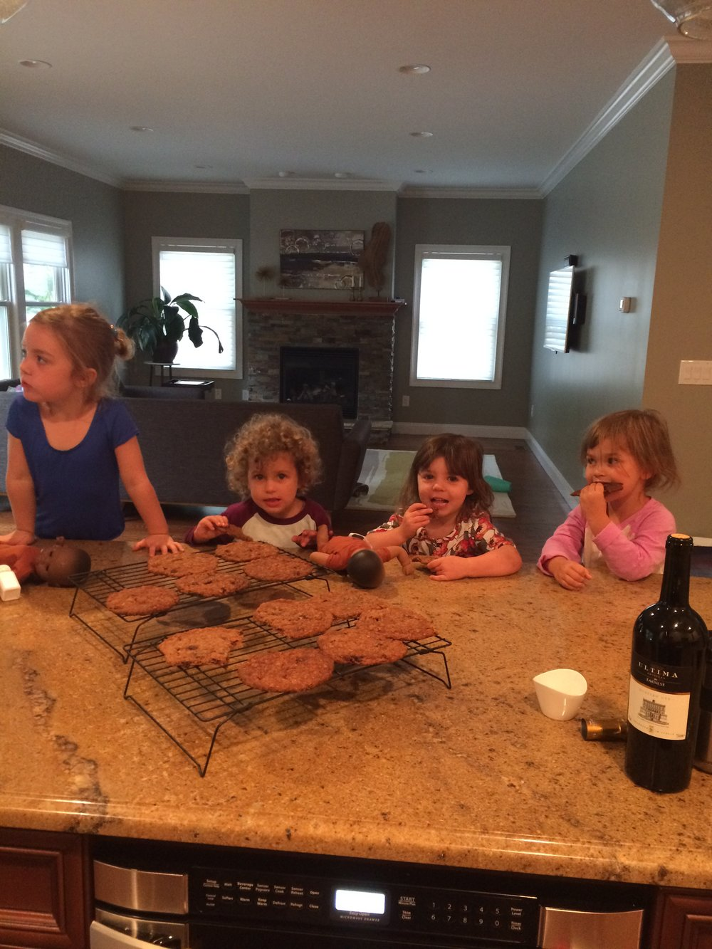 Our kids eating Erin's giant oatmeal cookies