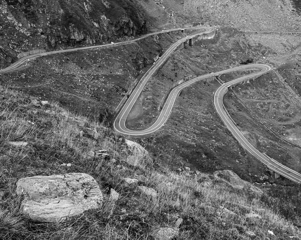 Hairpin turns and S-bends loop up the side of the hills at impossible angles of the north section of the Transfagarasan