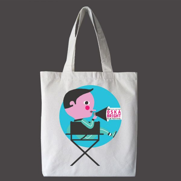 An Oska Bright Film Festival white tote bag with illustrated design by Billy Mather - features a man on a chair with a megaphone.