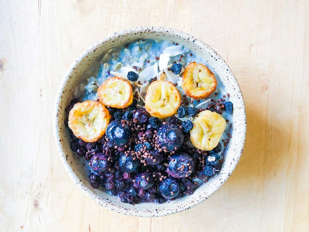 Bright blue bowl of oatmeal and citrus