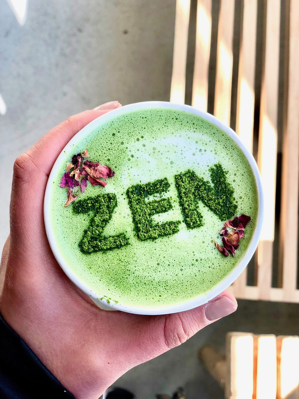 Matcha with ZEN etched on top and rose petals