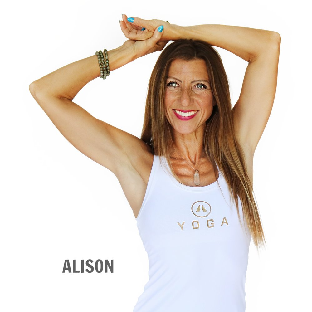 sports academy yoga instructor smiling with arms over head