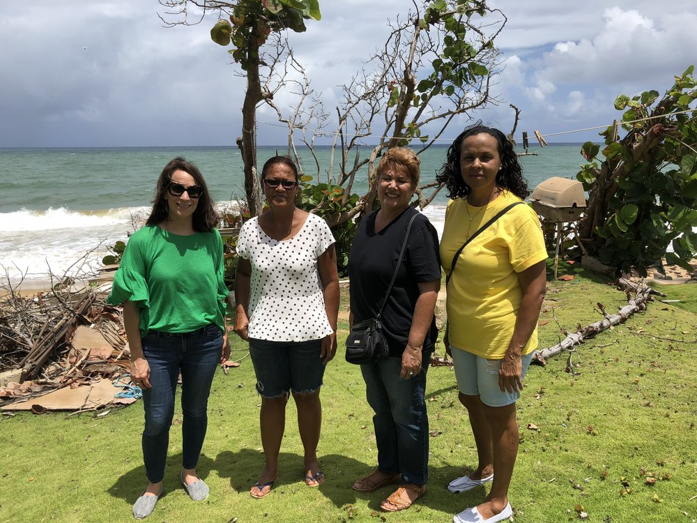 Yanel de Ángel (left) meeting with a coastal community to understand ongoing recovery needs.