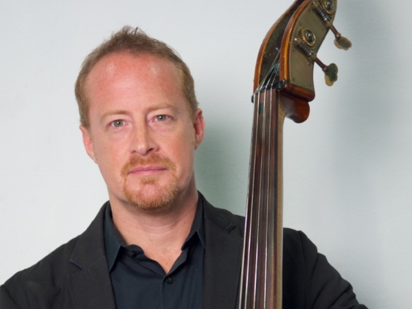 Utah Hamrick - Dr. Utah Hamrick is the Director of Jazz Studies at Texas State University, where he conducts the Jazz Ensemble and Jazz Lab Band, amidst teaching numerous courses. With his stand up bass, he has performed alongside the likes of Willie Nelson and jazz luminaries such as Houston Person, Byron Stripling, Larry Ham, and Bill Watrous. Utah has been performing alongside Graham for the past eight years, including work with Golden Arm Trio, Ballet Austin, Forklift Danceworks, and on the motion picture soundtracks for Bernie and All is Bright. More on Utah can be found on Texas State's website.
