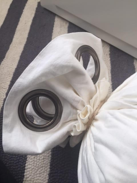 www.JadoreleDecor.com | Learn how to make a no-sew bolster cover from a pair of curtains. | DIY