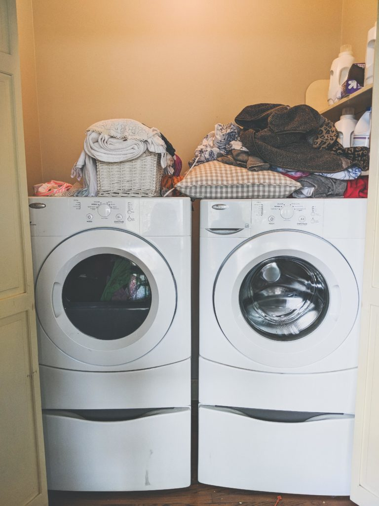 Source: Crystal,    The Holliday Collective    | Laundry Room BEFORE