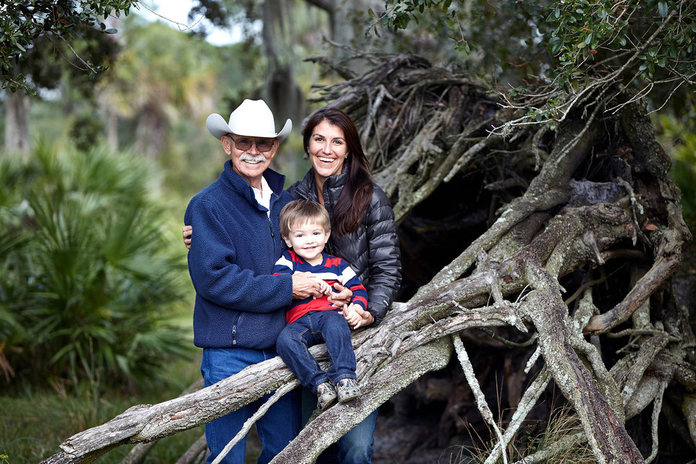 Ralph Pelaez with his daughter, Stephanie Pelaez and grandson McKinley on their 1,375-acre ranch in Okeechobee County. Photo by Randy Batista.