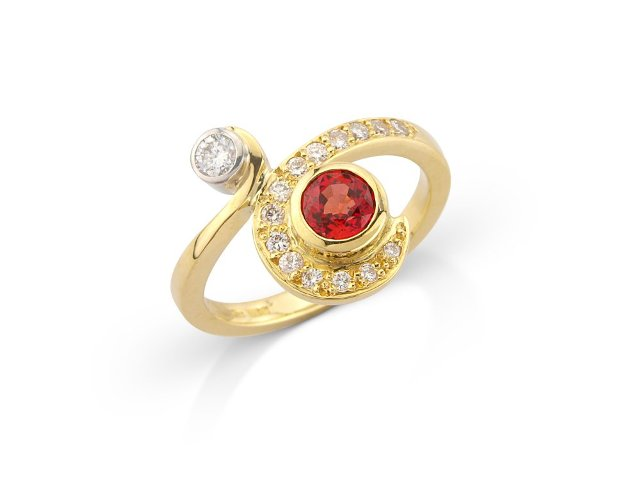 A  dark beautifulpadparadscha sapphire and diamonds in 18ct gold