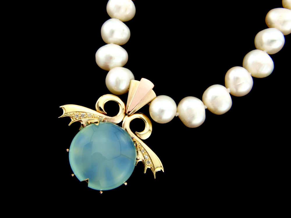 A lush chalcedony in gold with diamonds on pearls  the back of this design featured a flower with a diamond at its centre
