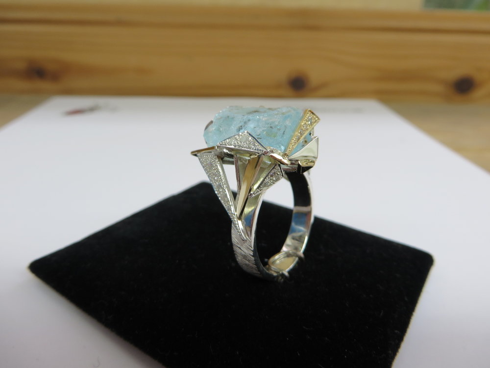 Designed by QVJ commission by a regular client silver and gold with a rough aquamarine and diamonds thrown in all over this.