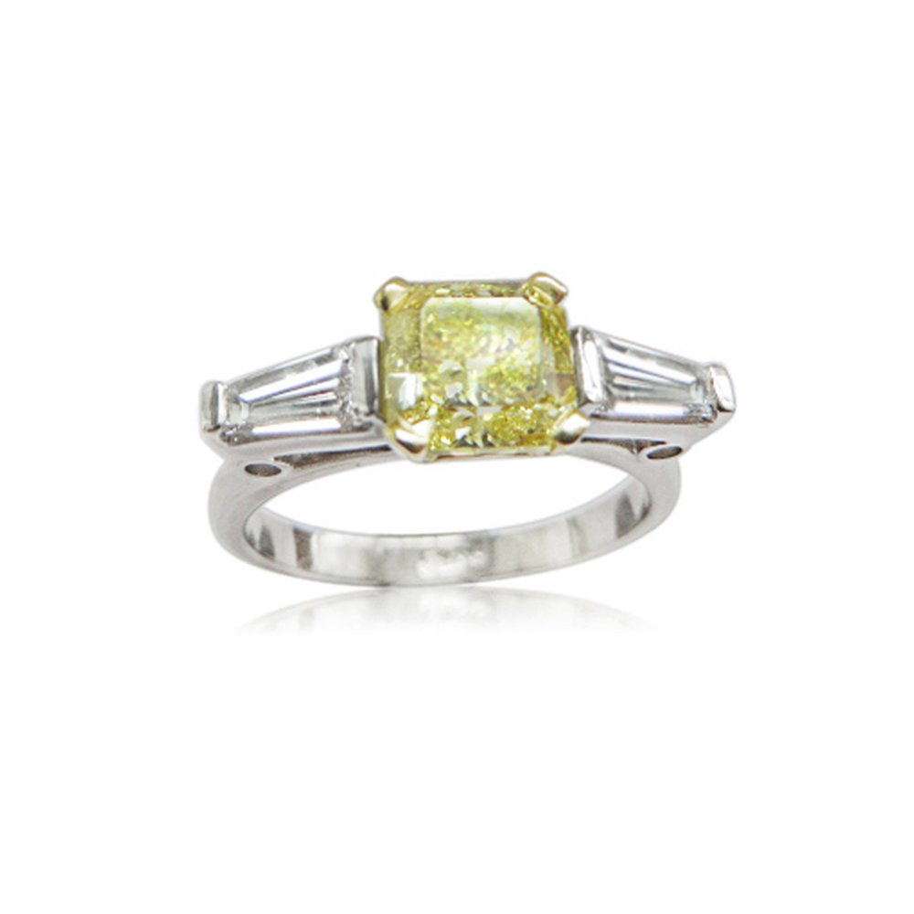 Wow so this is an Asscher cut internally flawless natural fancy vivid yellow diamond  being 1.48 carats flanked by two D colour vvs1 quality tapered baguette diamonds total carat weight 35 points ,all stones sourced by QVJ and mounted by us in a hand made ring for a very lucky and lovely client she say yes........