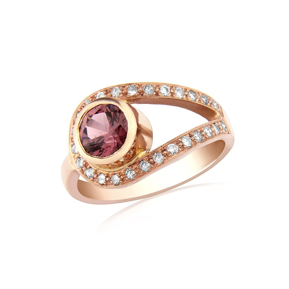 Diamond cut Rhodolite Garnet and diamond dress ring mounted in red gold.