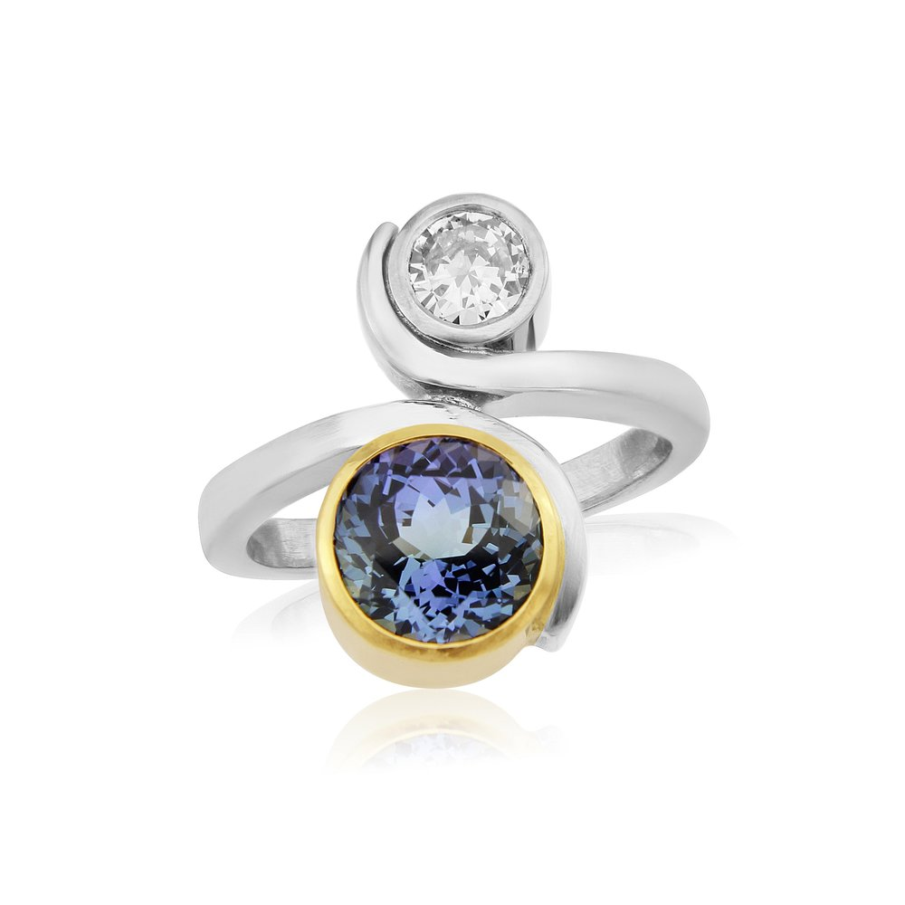 Gorgeous precision cut untreated unheated Tanzanite being 2.8 carats in size opposing a 0.48ct Diamond being F colour and VVS quality  hand made by QVJ  in  an 18 ct Gold mount.  ring size O  AVAILABLE