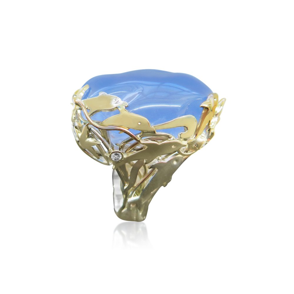 A real piece of collectable chalcedony untreated and a gorgeous blue in colour ,hand made in Silver and Gold and set with Diamonds.