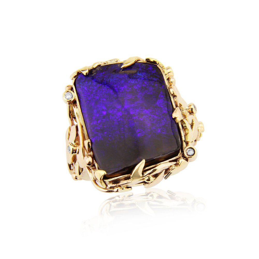 Beautiful deep blue Australian bolder opal in a 9ct gold hand made mount and set with accent diamonds.