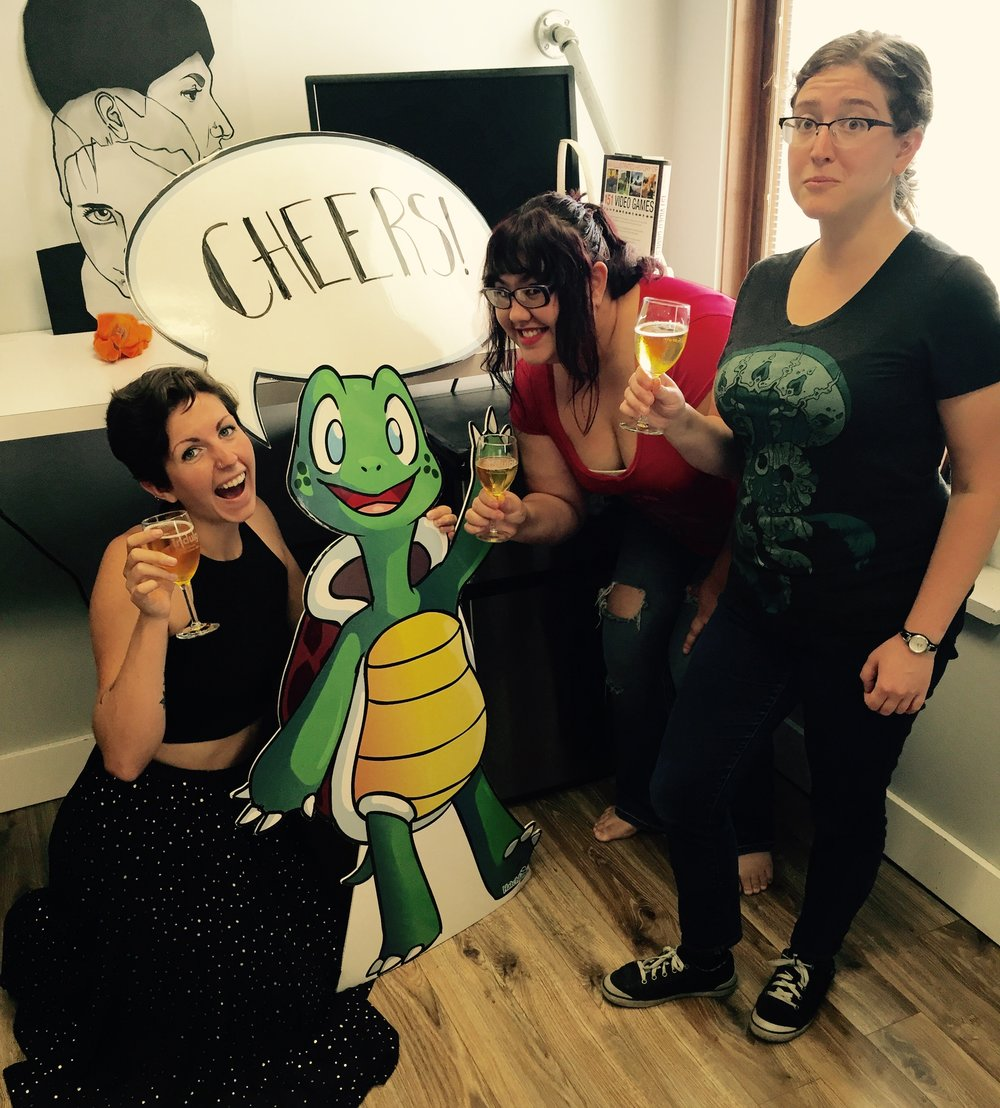The Hatchlings team at Gravitate with their mascot Sheldon the Turtle.