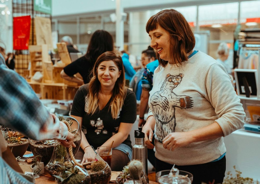 Abby Rowling, Community Manager of the Gravitate Downtown location and Andraa Metzler at an Art Terrarium popup.