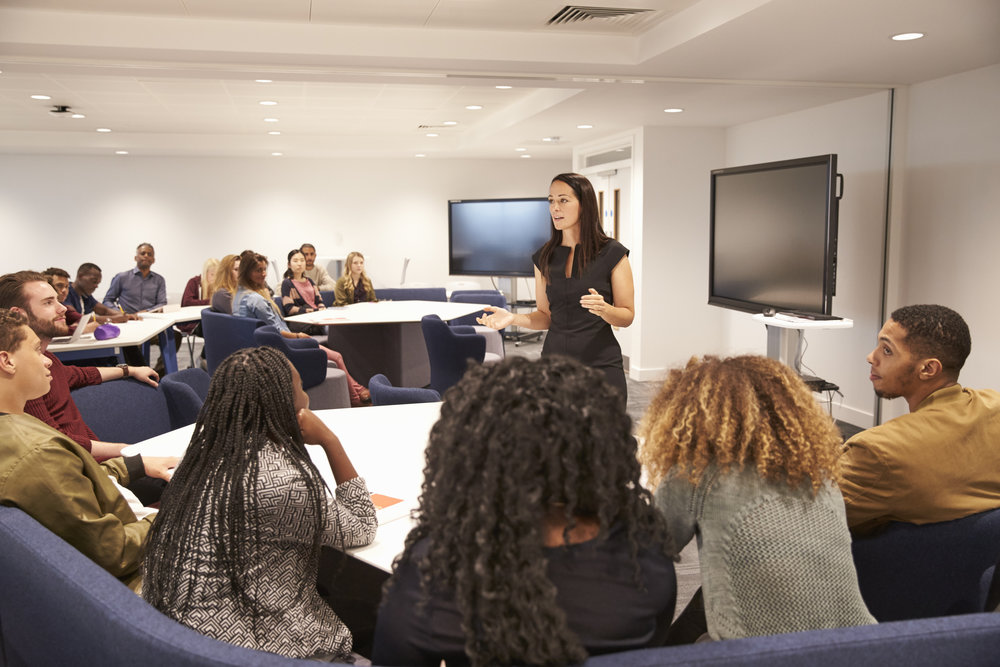 Woman teaching class in corporate classroom