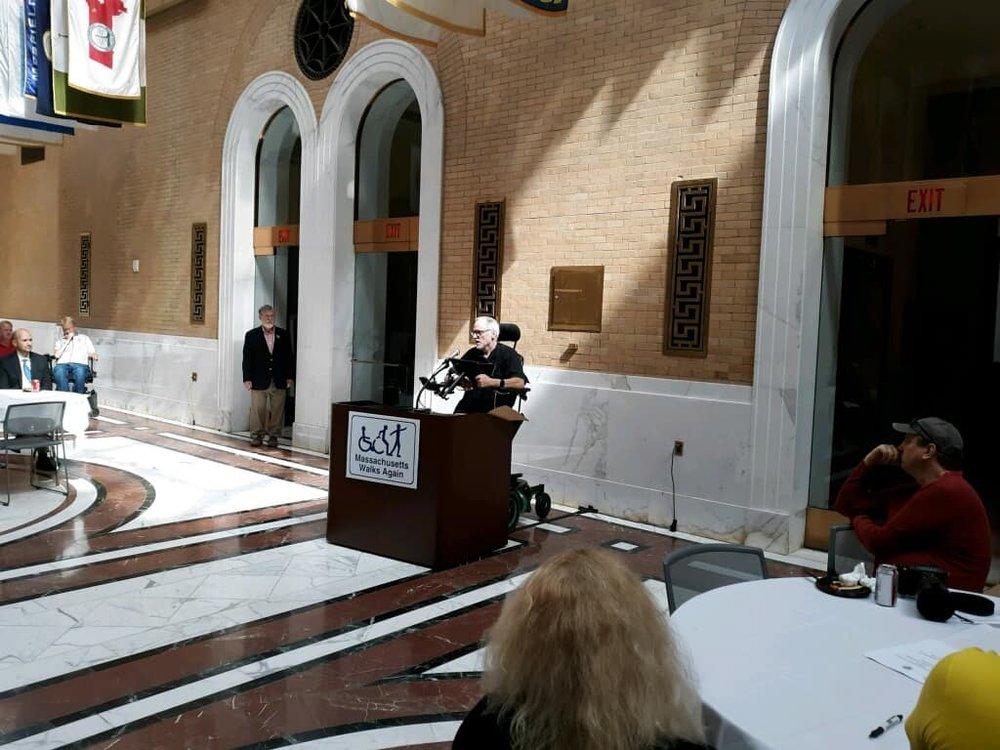 Chris Speaking to Legislators at Massachusetts State House for SCI Awareness Day.