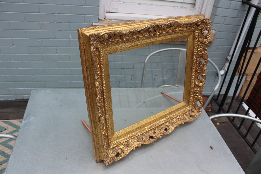 "Glass: 14 x 11 Frame: 19.5"" x 16"" - Has a table top stand!"