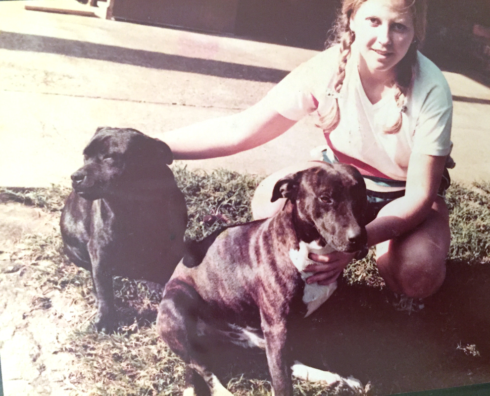 Griet with our 'Stafford-cross' pets (1977).