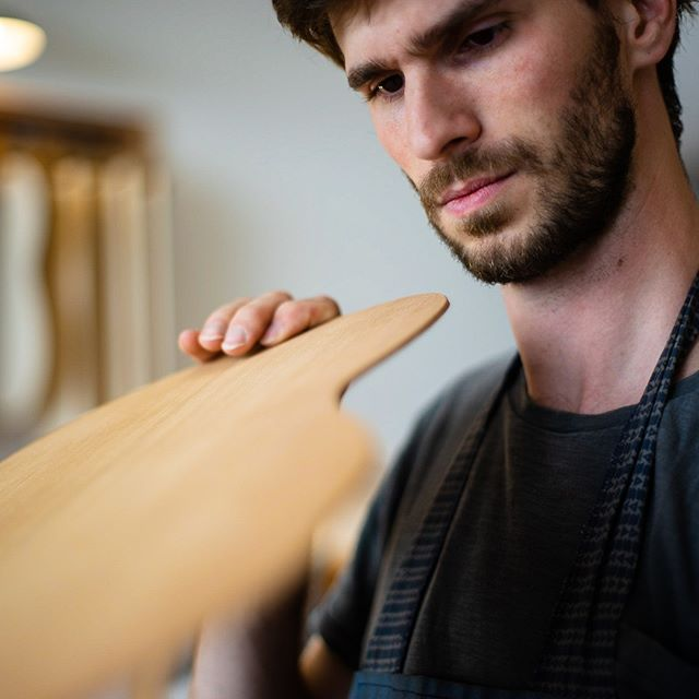Checking the stiffness of the top. In this case, I'm bending the top between my hands.  #classicalguitar #classicalguitarmaking #luthier #guitarbuilder #guitarmaking  #whatsonyourbench  #wood  #woodworking #workshop #workbench #cedartop #guitartop #guitarporn #musicalinstrument #sonyalpha #berlin #boutiqueguitars #instaguitars #guitarsofinstagram #guitarsarebetter #berlinluthiers