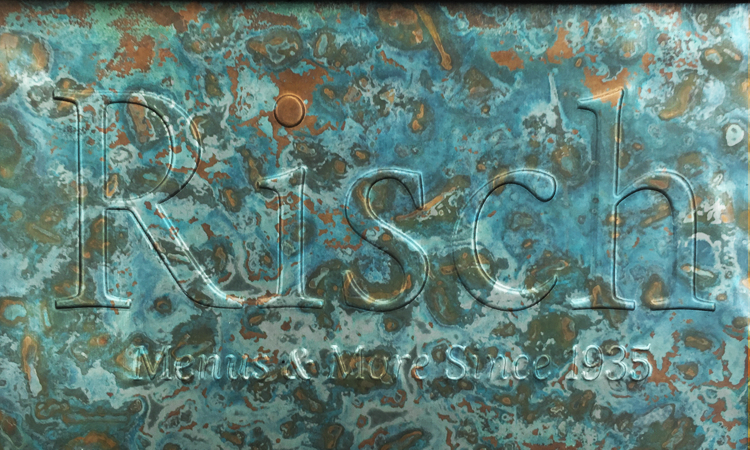 Embossed logo on Patina Azul cover