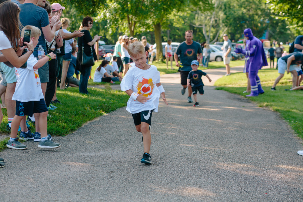 Max, determined and fierce, finishes a one mile run at the 2018 Fight for 5K and Fun Run.
