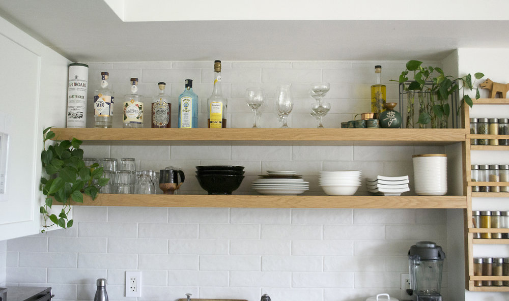 "A reminder: Waldek is a bartendar which is why our shelves may be a little ""boozier"" than the average kitchen"