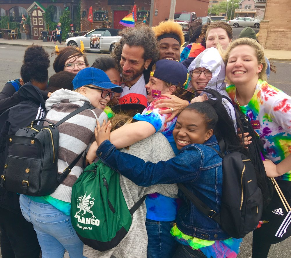 BRCSJ Chief Activist surrounded by love of GSA kids.JPG