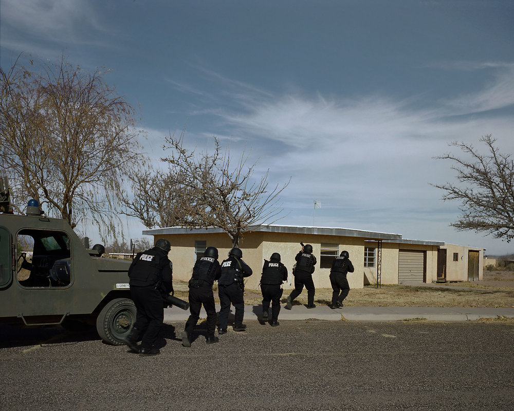 "SWAT team approaching house (""Terror Town"", Playas Training Center, New Mexico) 2005."