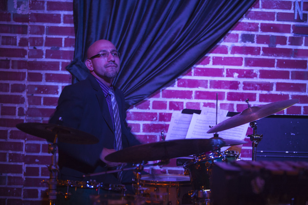 MANUEL LOPEZ - Born and raised in Colorado, Manuel Lopez grew up with a great passion for music. Having a natural taste for Latin music he began playing congas in his early teen years. Not too long after he picked up a pair of drum sticks and began playing the drums. Manuel then went on to study Music performance at the University of Northern Colorado, then later at the University of Denver. Performing now for over 10 years his career has led him to perform with great musicians in all genres of music such as Paquito D'Rivera, Dave Valentin, Marc Quiñones, Steve Turre, Jane Bunnett, Chuchito Valdez, Babbi Mason, and Rebecca Mauleon. Fluent on all Latin percussion instruments his abilities have opened up opportunities to teach others, which he now does in balance with performing.